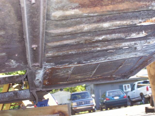 Factory floor pan.  Front patch panel.