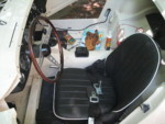 Driver's seat installed.  Still have to drill holes for seat belt points.