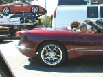 Vette with custom bodywork (New Vette on Chevy transporter --with the same cars as on the TV commercial--in the background)