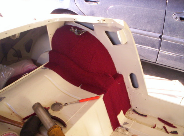 """OK, so here is the next piece of carpet I added. Just covers the reinforcement  all the way to the floor and over to the side panel. The """"lift the dot"""" stud is installed also, can just barely see it poking through the carpet. The threads are cleaned for the seatbelt bracket, I just have the arch bracket on there loosely for now. Am planning on getting 3 point belts, just feel better about having them even though it's not a requirement for this old of a car. The other side will be like this side, and just one larger piece in the middle."""